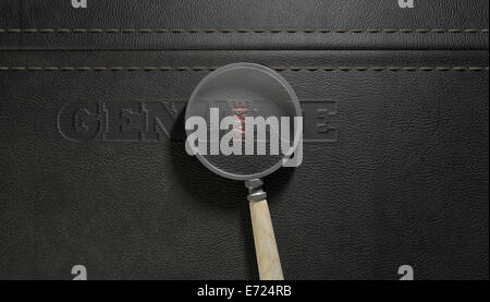 A concept image showing a regular stitched sheet of black leather with an embossed stamp reading genuine but magnified - Stock Photo
