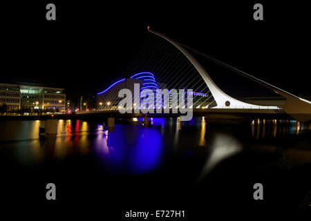 An illuminated Samuel Beckett Bridge that spans the River Liffey in Dublin city, Ireland. - Stock Photo