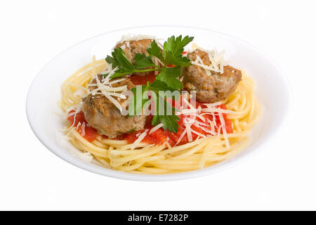 serving of spaghetti with meatballs in tomato sauce on white plate - Stock Photo