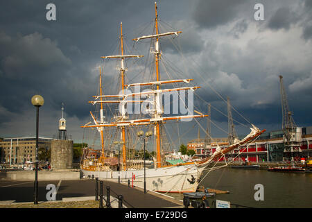 Storm clouds hover over the SS Kaskelot in the harbor at Bristol, England - Stock Photo