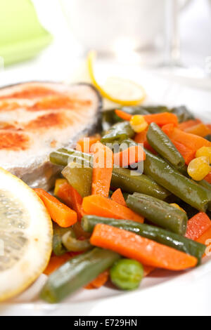 Grilled Salmon Steak with Vegetables and Lemon - Stock Photo