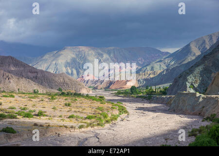 Riverbed of the Purmamarca and Cerro de los Siete Colores or Hill of Seven Colors in Purmamarca, Jujuy Province, - Stock Photo