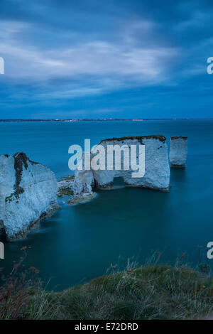 Twilight over the white cliffs and Harry Rocks at Studland, Isle of Purbeck, Jurassic Coast, Dorset, England - Stock Photo
