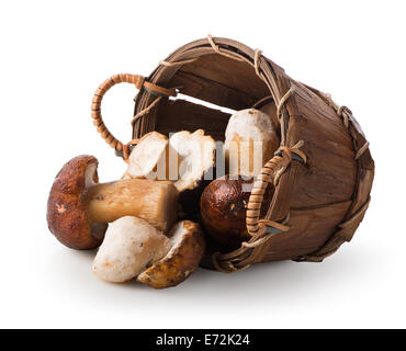 Mushrooms in a wooden basket isolated on white - Stock Photo