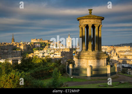 Dugald Stewart Memorial and Edinburgh dawn viewed from Calton Hill, Edinburgh, Lothian, Scotland - Stock Photo