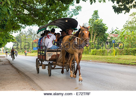 Horse drawn carriage with passengers in Cuba - Stock Photo