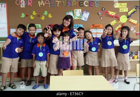Ho Chi Minh, Vietnam. 5th Sep, 2014. A teacher and students of Wellspring Saigon International Bilingual school - Stock Photo