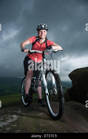 Female mountain biker in the Peak District, UK - Stock Photo