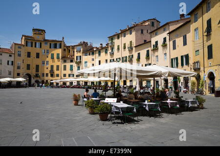 Restaurants in the Piazza Anfiteatro Romano, Lucca, Tuscany, Italy, Europe - Stock Photo