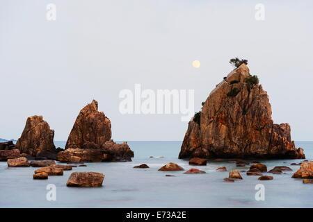 Full moon rising over rock stacks, Hashikuiiwa, Wakayama Prefecture, Honshu, Japan, Asia - Stock Photo