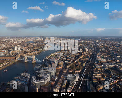 Aerial cityscape showing River Thames, Tower Bridge and railway tracks, London, England, United Kingdom, Europe - Stock Photo