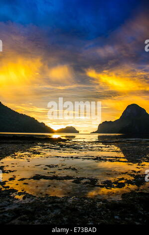 Dramatic sunset light over the bay of El Nido, Bacuit Archipelago, Palawan, Philippines, Southeast Asia, Asia - Stock Photo