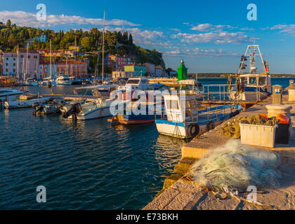 Fishing nets and fishing boats, Old Town Harbour, Piran, Primorska, Slovenian Istria, Slovenia, Europe - Stock Photo