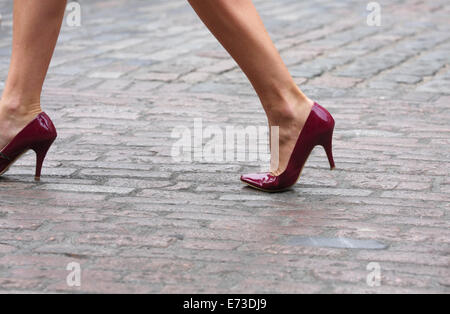 The legs of a female walking in high heels in Covent Garden, London - Stock Photo