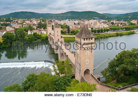 High angle view of medieval Pont Valentré bridge over the Lot River and town of Cahors, Lot Department, Midi-Pyrénées, - Stock Photo
