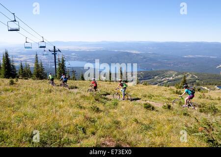 A family ride their bikes in Whitefish, Montana. - Stock Photo