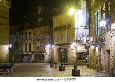 Old buildings on Place du Peyrou at night, Sarlat-la-Canéda, Dordogne Department, Aquitaine, France - Stock Photo