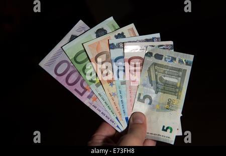 Many euro banknotes, 29 August 2014 in Hamburg. - Stock Photo