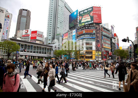 Shibuya crossing, Tokyo, Japan, Asia. Street, road, pedestrians, people, buildings, signs, advertising billboards - Stock Photo