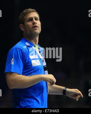 Magdeburg, Germany. 29th Aug, 2014. Magdeburg's Geir Sveinsson stands on the sideline as he instructs his players - Stock Photo