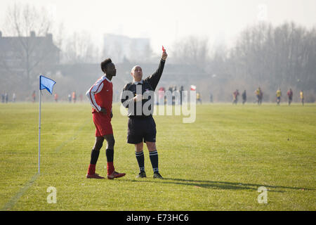 Hackney Marshes Sunday league, player gets marching orders. - Stock Photo