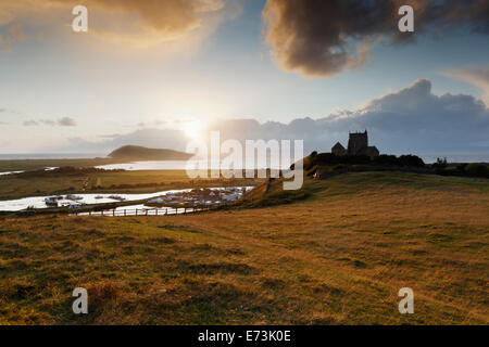 Sunset over The Old Church of St Nicholas with Brean Down in the distance. Uphill, Somerset, England, UK. - Stock Photo
