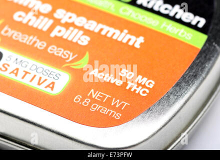 Close-up on the words 50 MG Active THC on a tin of 'Sublime Spearmint Chill Pills,' a form of legal edible marijuana - Stock Photo