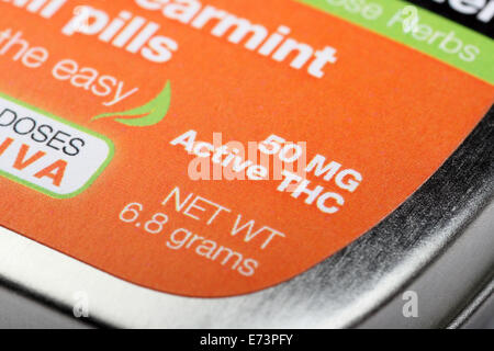 Close-up on the words 50 MG Active THC on a tin of 'Sublime Spearmint Chill Pills,' a form of edible marijuana legal - Stock Photo