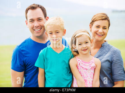 Portrait of Happy Family Outside - Stock Photo