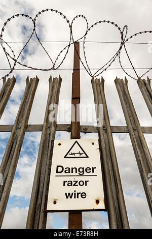 Danger, razor wire security fence, England, UK - Stock Photo