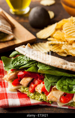 Healthy Grilled Chicken Pesto Flatbread Sandwich with Peppers and Spinach - Stock Photo