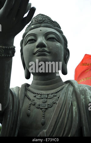 One of the six bronze statues, 'The Offering of the Six Devas' circling the base of the Tian Tan Buddha (Big Buddha), - Stock Photo