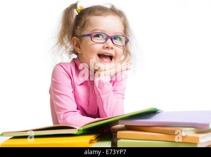 Funny kid girl in glasses reading books - Stock Photo