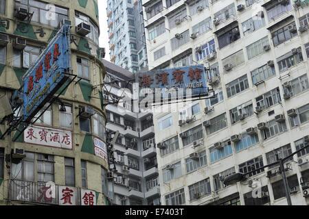 Signs advertising accommodation, amongst buildings of apartments and flats. Kowloon, Hong Kong, China