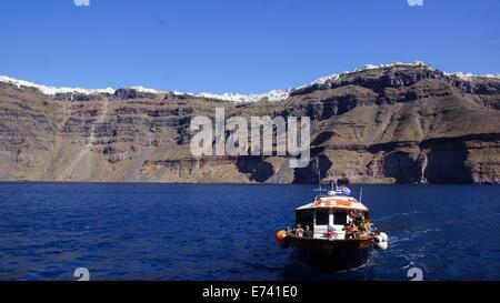 Boat for tourists in Santorini gulf. - Stock Photo