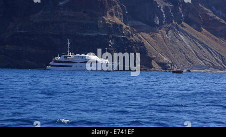 Boats for tourists in Santorini gulf. - Stock Photo