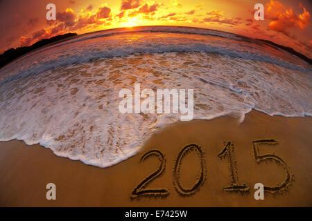 new year 2015 digits on ocean beach sunset - Stock Photo