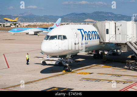 Busy scene at Palma Airport in Majorca including a Thomas Cook Boeing 757 and Thomson and Euro Poste Boeing 737s - Stock Photo