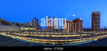 Leeds city skyline of modern architecture and rail tracks in the foreground, Leeds, England. - Stock Photo