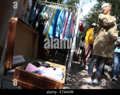 ITAR-TASS: MOSCOW, RUSSIA. SEPTEMBER 6, 2014. Clothes for sale at the Lambada market in Moscow's Pokrovsky Boulevard. - Stock Photo