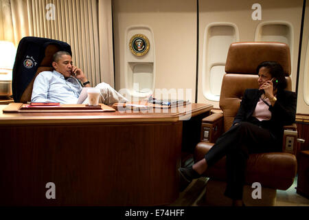 President Barack Obama, aboard Air Force One, talks on the phone with President Hamid Karzai of Afghanistan - Stock Photo