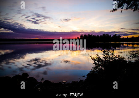 Sunset on Spectacle Pond, Osborn, Maine - Stock Photo