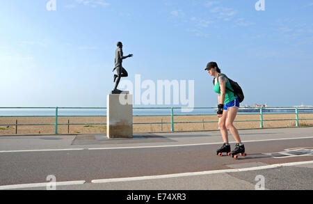 Brighton, Sussex, UK. 7th Sep, 2014. Weather: A roller blader passes the Steve Ovett statue on Brighton seafront - Stock Photo