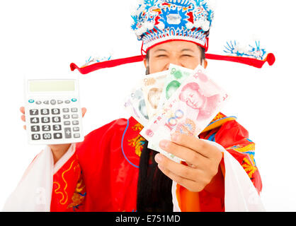 God of wealth holding a compute machine and chinese currency - Stock Photo