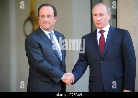 Russian President Vladimir Putin shakes hand with French President Francois Hollande at Elysee palace in Paris, - Stock Photo