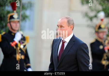 Russian President Vladimir Putin meets French President Francois Hollande at the Elysee Palace in Paris - Stock Photo