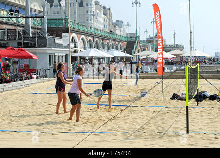 Brighton, Sussex, UK. 7th Sep, 2014. Weather: young women playing beach tennis as crowds enjoy the hot weather this - Stock Photo