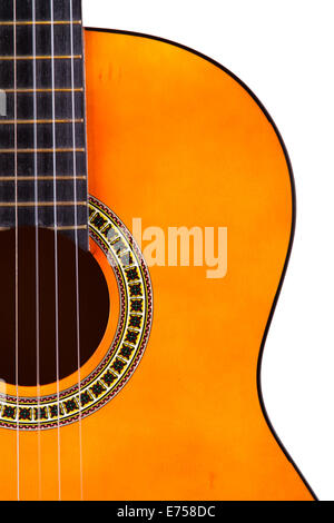 Detail view of orange wooden classical acoustic guitar, isolated on white background. Stock Photo