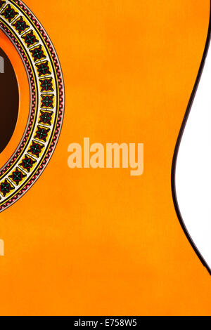 Detail of orange wooden classical acoustic guitar. Stock Photo
