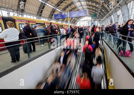 Blurred motion image of passengers on platforms at Alexanderplatz railway station on the S-Bahn in Berlin Germany - Stock Photo